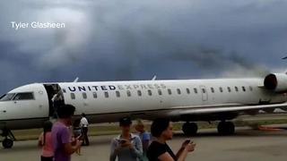 Plane engine catches fire during landing - Video