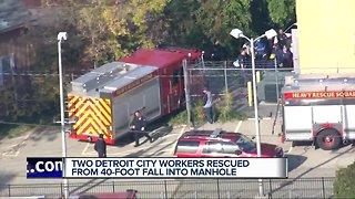 Two workers rescued after falling down manhole in Detroit