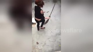 She Was Sweeping A Great Job, Until She Got Chased In Circles By A Rat - Video