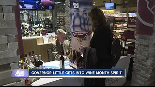 Governor Brad Little signs bottles of wine for Idaho Wine Month