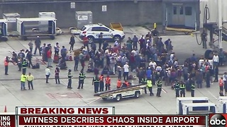 Witness describes chaos inside airport - Video