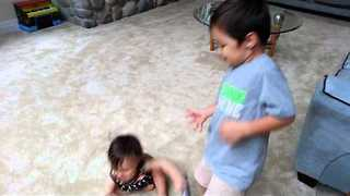 Big Brother Helps Adorable Sister Learn How to Walk - Video