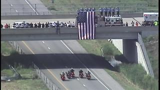 Body of fallen Officer Gary Michael escorted back to Clinton - Video