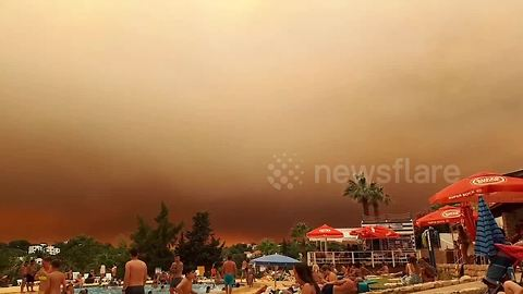 Looks like a holiday of horror! Tourists shocked by huge cloud of smoke filling the sky