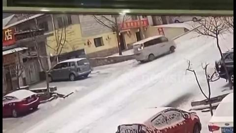 Driver Spins On Icy Road But Manages To Park Almost Perfectly