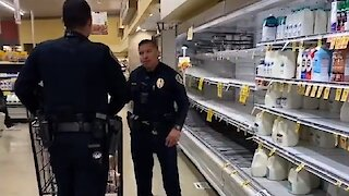 San Diego police officers help elderly man do his shopping