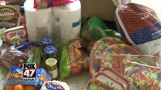 DeWitt neighborhood comes together to bring Thanksgiving to local family in need - Video