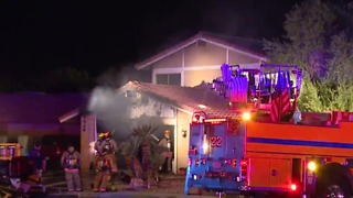 Garage fire forces family to evacuate near Jones, Twain - Video