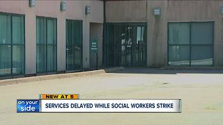 160 Lorain County Jobs and Family Service workers on strike over benefits - Video