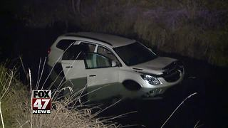 Woman hospitalized after SUV crashes into creek - Video