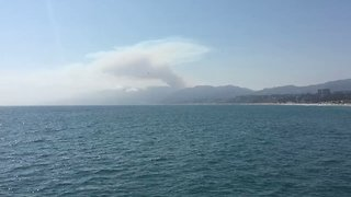 Smoke From Topanga Wildfire Seen From Santa Monica Pier - Video