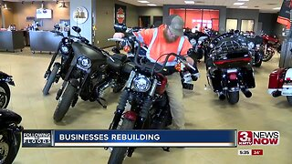 Businesses rebuilding year after major flooding