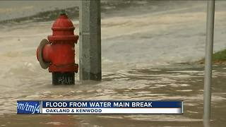 Water main break causes flooding on East side - Video