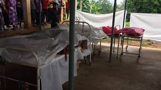 Bodies of Landslide Victims Lined Up in Hospital Morgue - Video