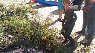 Little Boy Cannonballs Into Mud Puddle - Video