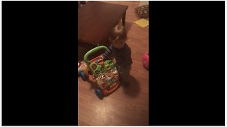 Baby Boy Loves To Dance To The Music Of His Walker - Video
