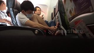 Airplane passenger picking his toe nails annoys fellow fliers - Video