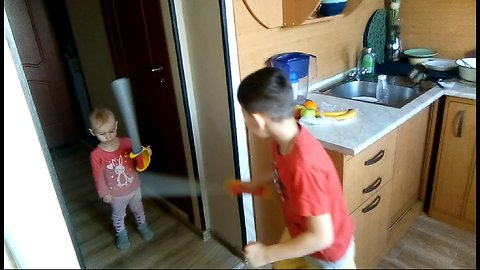 A little girl considers herself a knight and fights with a sword with an adult boy.