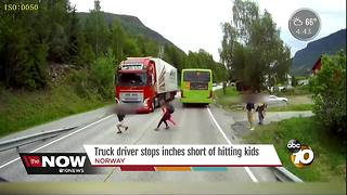 Truck driver stops inches short of hitting kids - Video