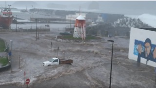 Waves Flood Harbor of Town in Azores During Storm - Video