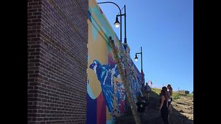 Akron students leave their mark on city with a colorful mural on Mill Street Bridge underpass - Video