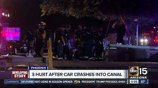 Three hurt after car crashes into Phoenix canal - Video