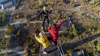 Don't look down! Daredevil friends rope jump from chimney almost 400 feet high - Video