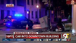 Car hits downtown Cincinnati building, catches fire after two-state police chase - Video