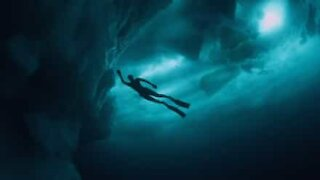 Woman swims under glaciers in Greenland