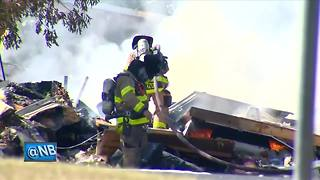 Man pleads guilty to killing wife found in exploded home - Video