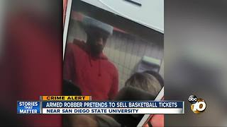 Armed robber pretends to sell basketball tickets - Video