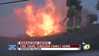Fire tears through family home - Video