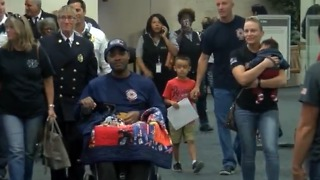 Local firefighter receives hero's welcome - Video
