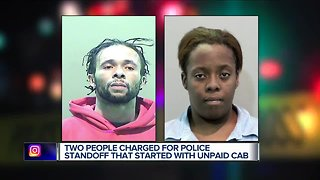 Two people charged for police standoff that started with unpaid cab