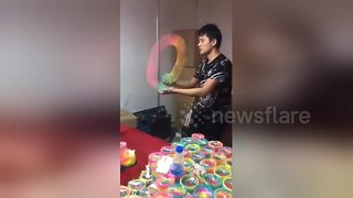 Master Slinky Salesman Wows Children With His Skills
