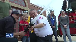 Boy battling cancer becomes firefighter for a day - Video