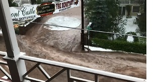 Road Becomes River as Floodwaters Cover Manitou Springs, Colorado - Video