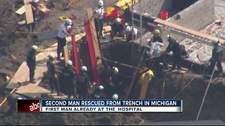 2 men trapped in collapsed trench rescued - Video