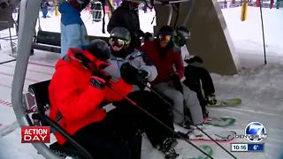 Holiday skiers take in the snow at Breckenridge - Video