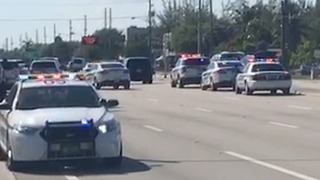 Section of Okeechobee Blvd. shut after a report of a man with a weapon - Video