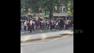 Crowds gather at cordoned-off area near luxury hotel - Video