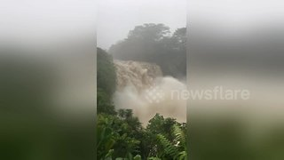 Hurricane Lane turns waterfall into raging cascade of floodwaters - Video