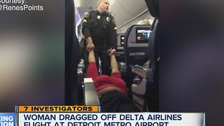 Woman dragged off plane at Metro Airport - Video