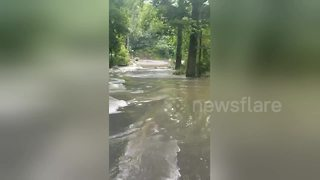 Flood waters wash out road in Pennsylvania - Video