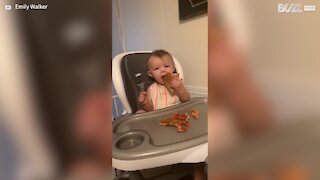 Baby's reaction to pizza is so adorable
