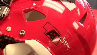 Helmet sticker gives athletic trainers the spotlight