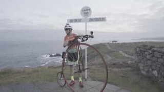 Fifty-five-year-old smashes world record on penny-farthing