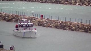 Three men rescued from Lake Michigan after boat capsized off coast of Port Washington - Video