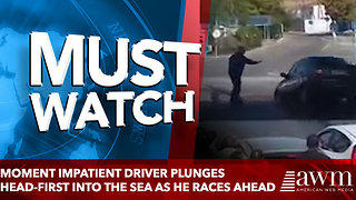 Moment impatient driver PLUNGES head-first into the sea as he races ahead - Video