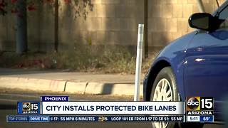City of Phoenix installs protected bike lanes - Video